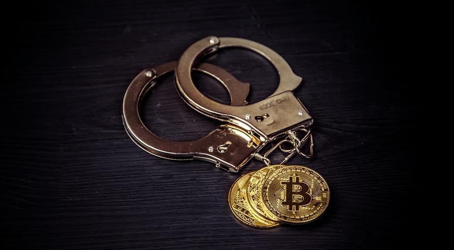 handcuffs on black wooden background